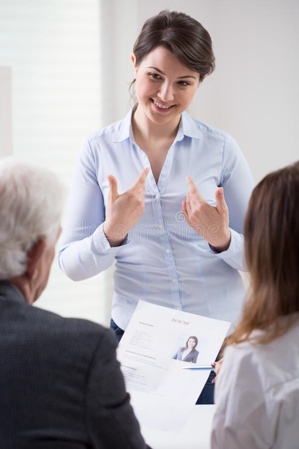 Happy woman during self presentation royalty free stock photo