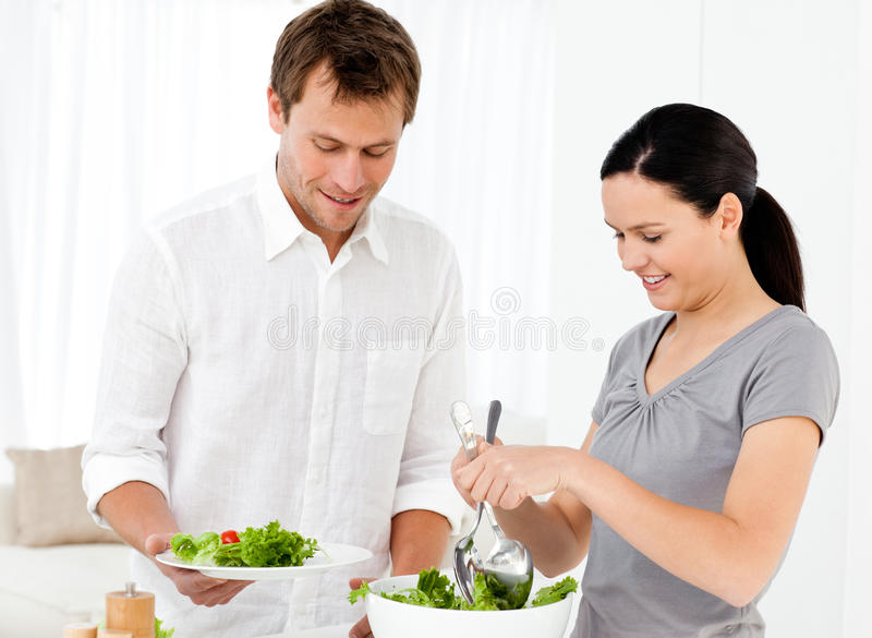 Download Happy Woman Serving Salad To His Boyfriend Stock Photo - Image: 17376244