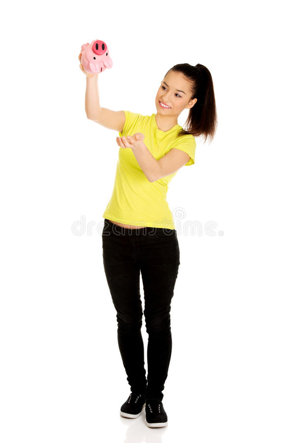 Happy woman shaking piggybank. royalty free stock photography
