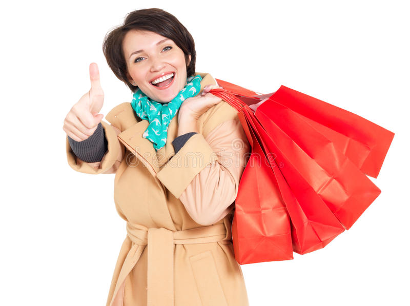 Download Happy Woman With Shopping Bags In Beige Autumn Coat Stock Photo - Image of cheerful, portrait: 29524930