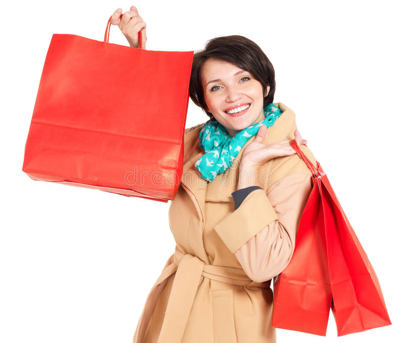 Download Happy Woman With Shopping Bags In Beige Autumn Coat Stock Photo - Image: 32576452