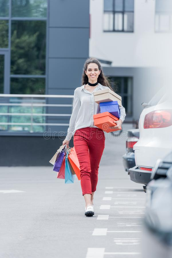 happy woman with shopping bags and boxes royalty free stock photography