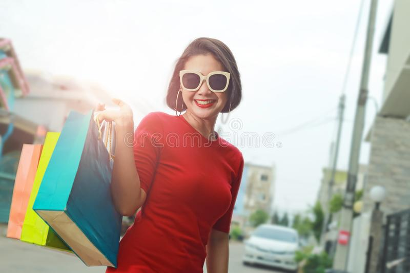 Happy woman with shopping bags enjoying in shopping outdoor royalty free stock photos