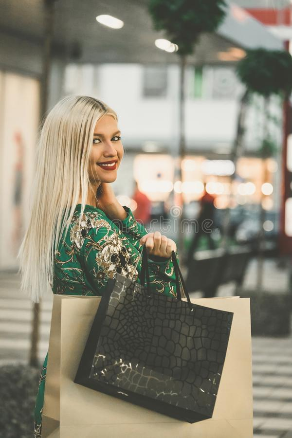 Happy woman with shopping bags enjoying in shopping stock images