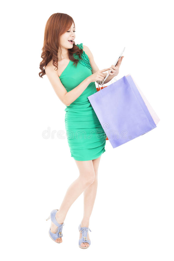Download Happy  Woman Shopping On The Internet By Tablet Pc Stock Photo - Image: 29597072