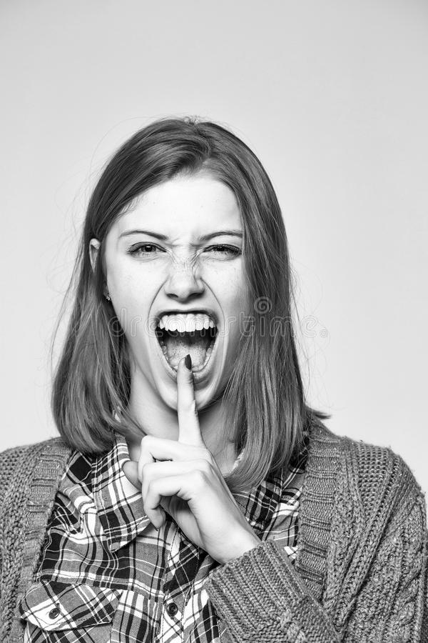 Happy woman. Shouting pretty girl or cute beautiful woman young female model with blonde hair shows silence gesture stock image