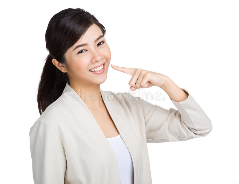 Happy woman show white teeth with finger royalty free stock photography