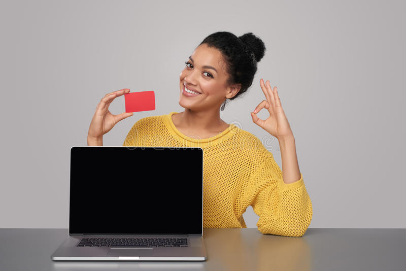 Happy woman showing blank black comuter screen stock photography