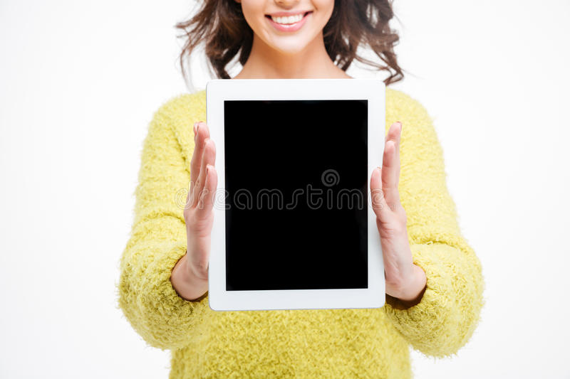 Happy woman showing blank tablet computer screen stock photo
