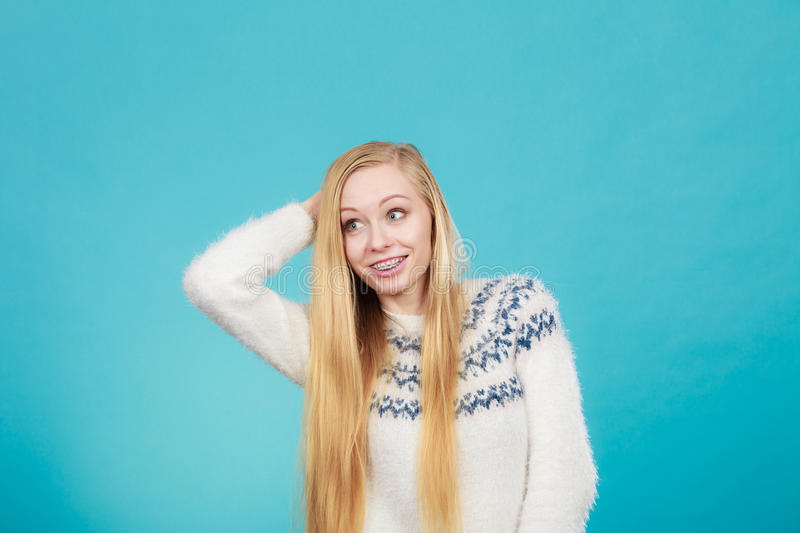 Happy woman showing her braces on teeth royalty free stock image