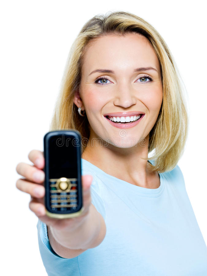 Happy woman showing mobile phone royalty free stock images