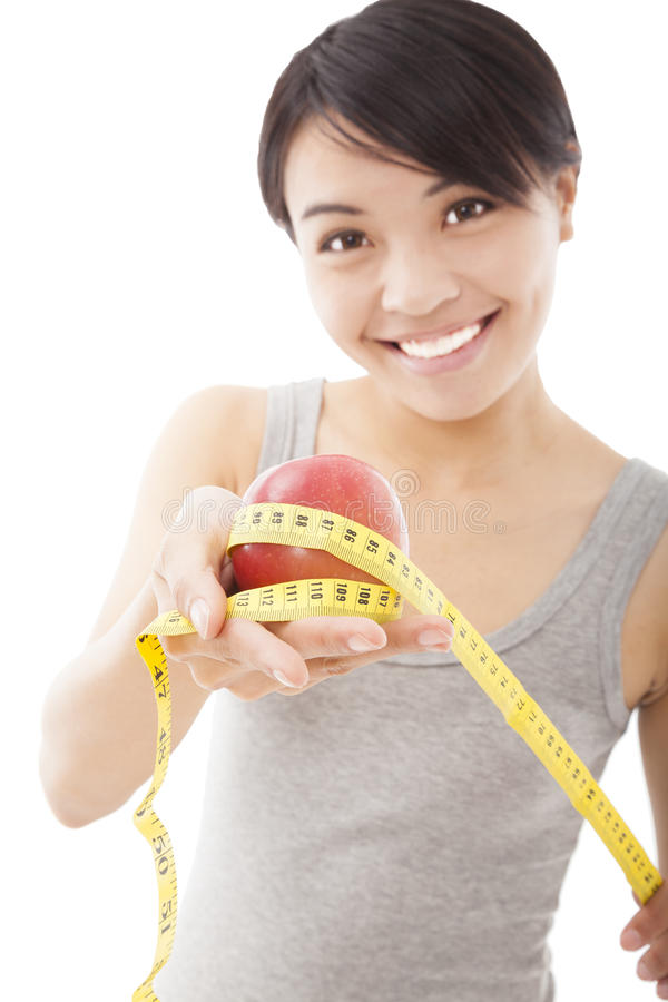 Happy woman showing scales and apple stock photo