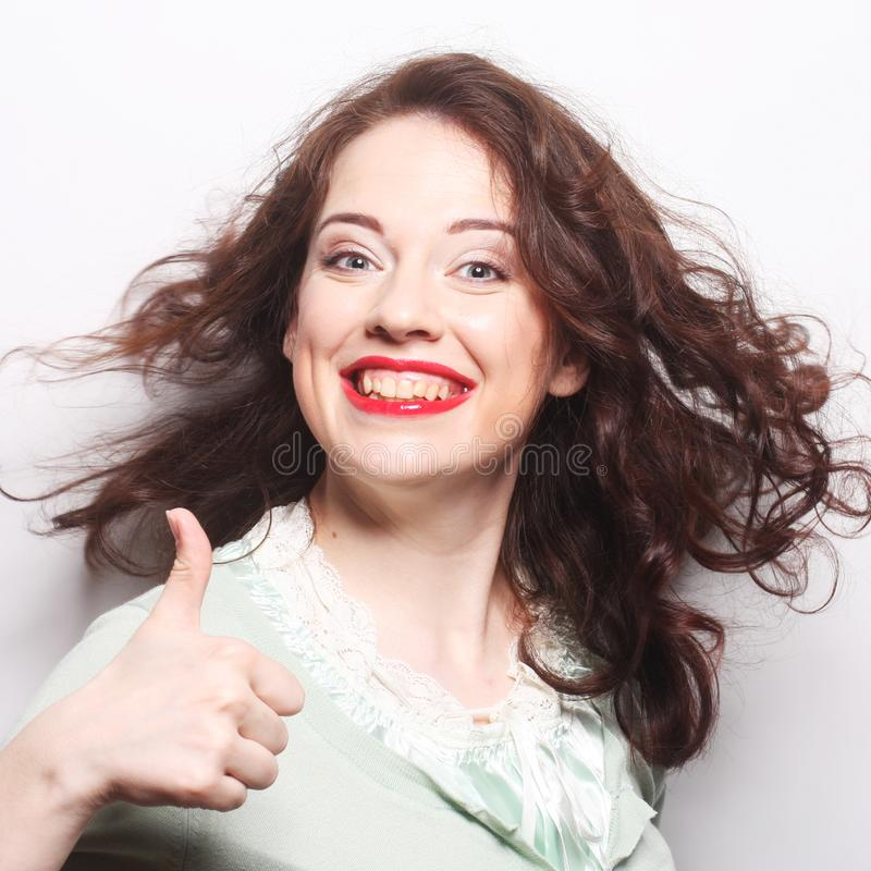 Happy woman showing thumbs up. Portrait of happy woman showing thumbs up royalty free stock photography