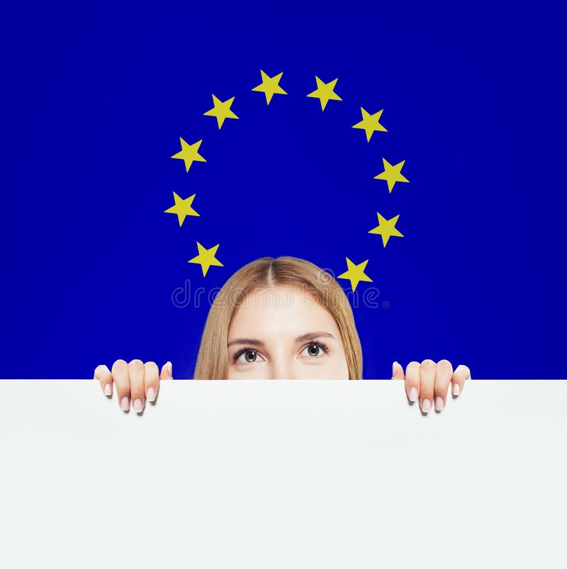 Happy woman showing white background against the EU flag royalty free stock images