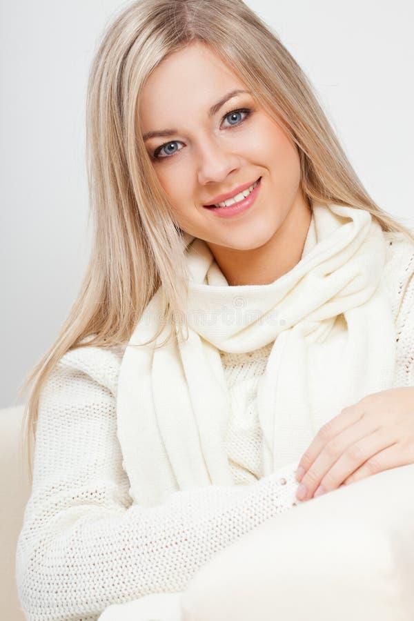Happy woman sitting stock image