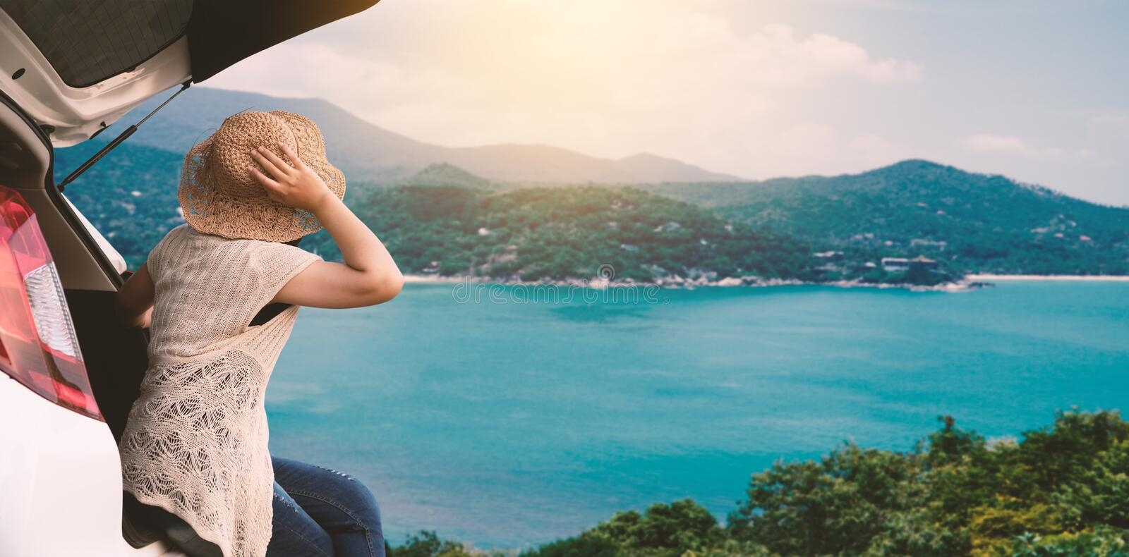 Happy woman sitting in the car and traveling summer season stock photo