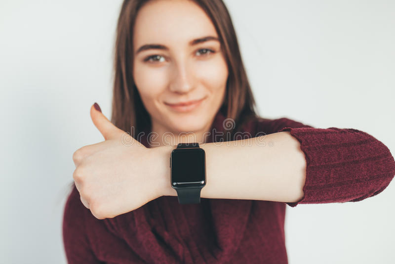 Happy woman with smart watch showing thumb up. royalty free stock images