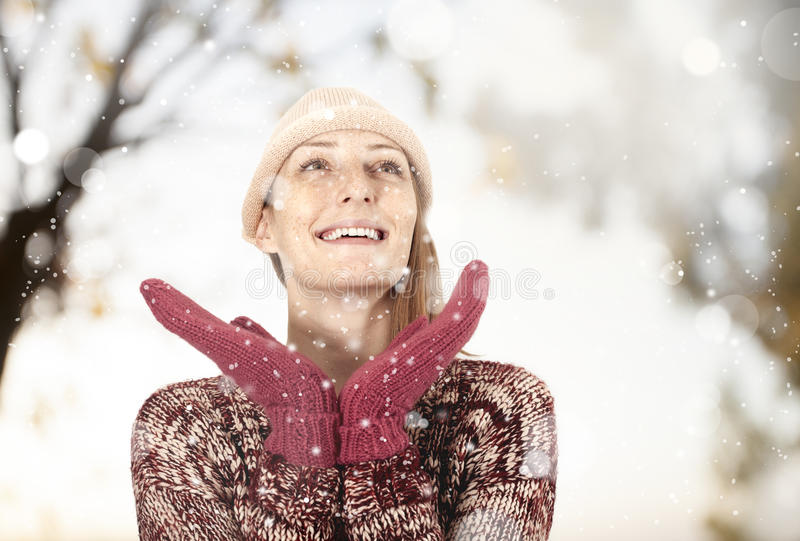 Happy woman in the snow royalty free stock photos