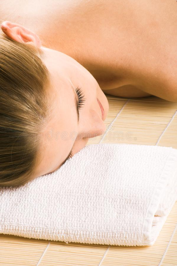 Happy woman in a spa stock images