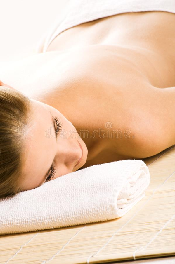 Happy woman in a spa stock photo