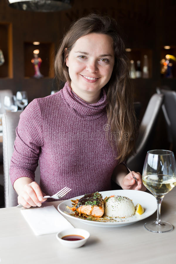 Happy woman spending her time in restaurant stock photos