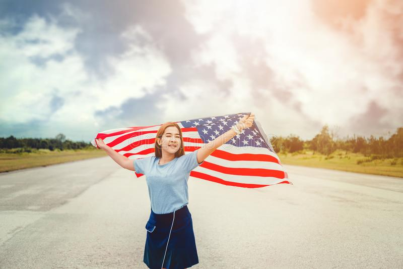 Happy woman standing with American flag Patriotic holiday.USA ce royalty free stock photography