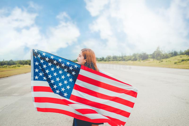 Happy woman standing with American flag Patriotic holiday.USA ce royalty free stock photos
