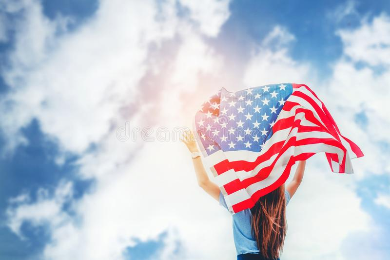 Happy woman standing with American flag Patriotic holiday.USA ce stock photography