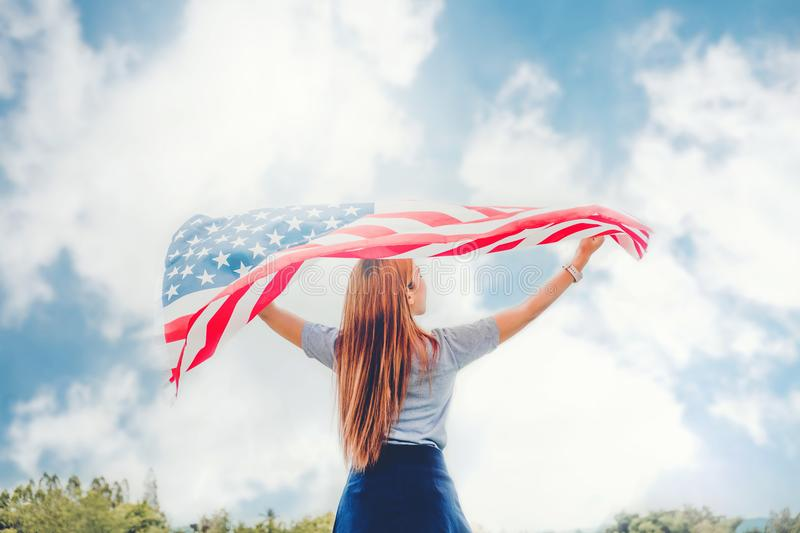 Happy woman standing with American flag Patriotic holiday.USA ce royalty free stock photo