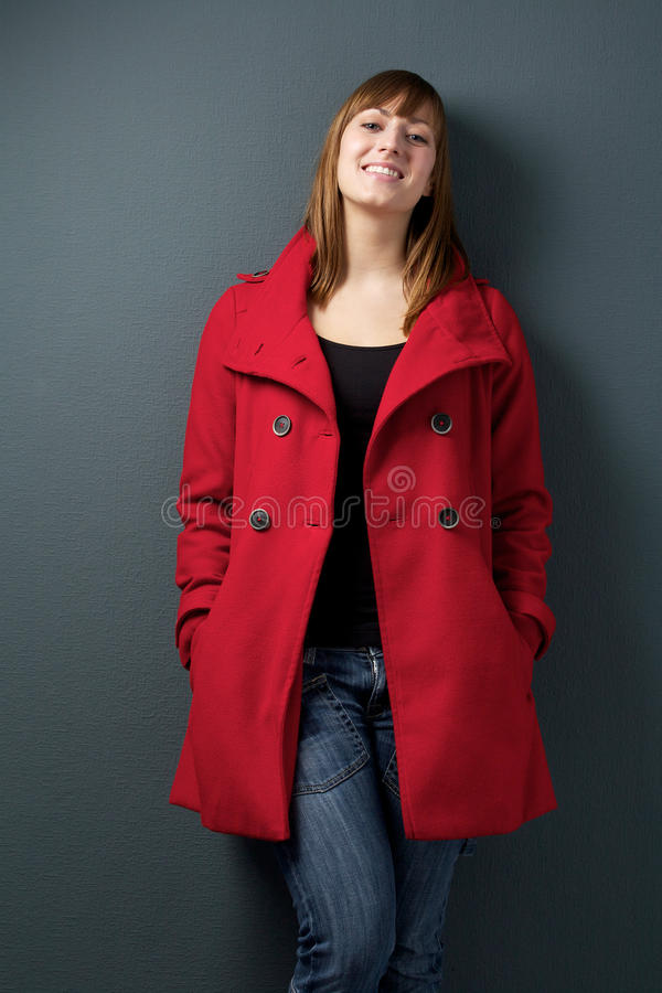 Happy Woman Standing On Gray Background Royalty Free Stock Image