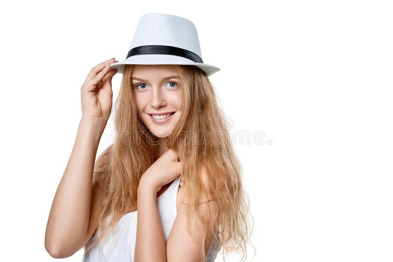 Happy woman in straw hat. Closeup of smiling woman wearing white fedora straw hat over white background royalty free stock photography