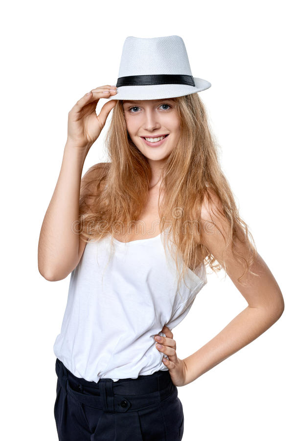 Happy woman in straw hat. Smiling woman wearing white fedora straw hat over white background royalty free stock images