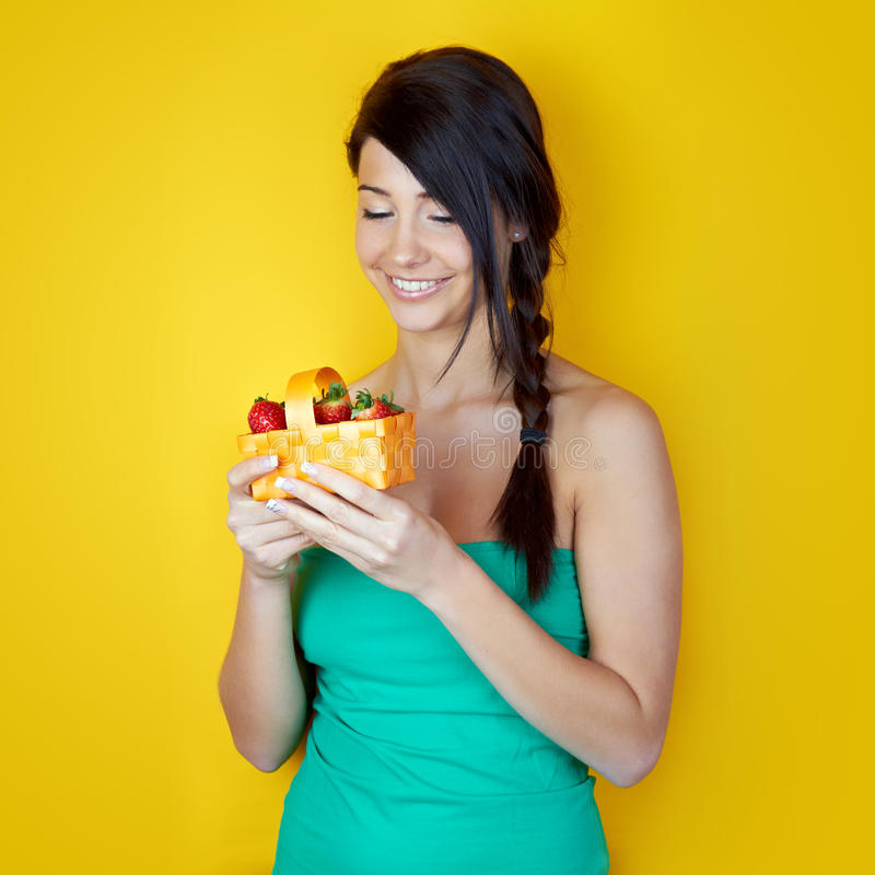 Happy woman with strawberries stock image