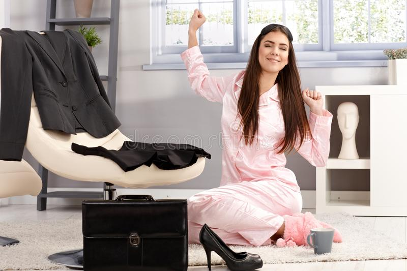 Happy woman stretching in pyjama stock photo