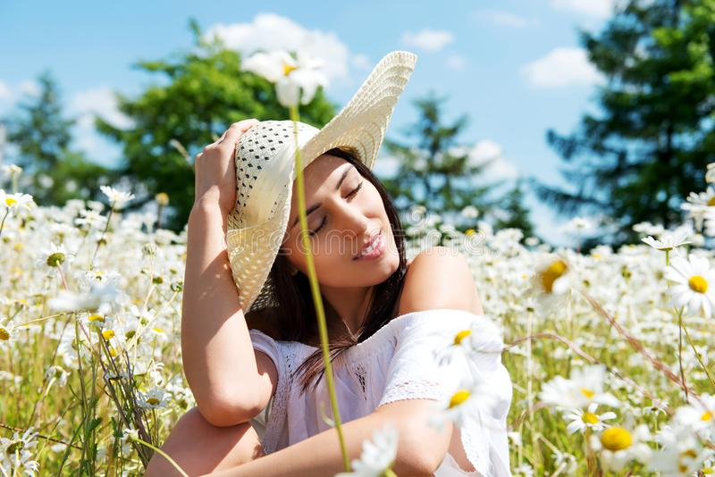 Happy woman in summer field. Young girl relax outdoors. Freedom concept. Happy woman in summer field. Young girl relax outdoors. Freedom concept royalty free stock photos