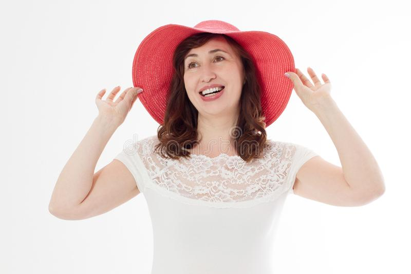 Happy woman in summer hat isolated on white background. Sun protection skin care and vacation holidays concept. Middle age female royalty free stock image