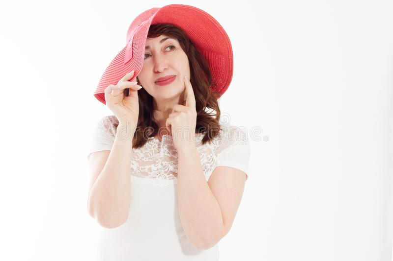 Happy woman in summer hat isolated on white background. Sun protection skin care and vacation holidays concept. Middle age female stock photography