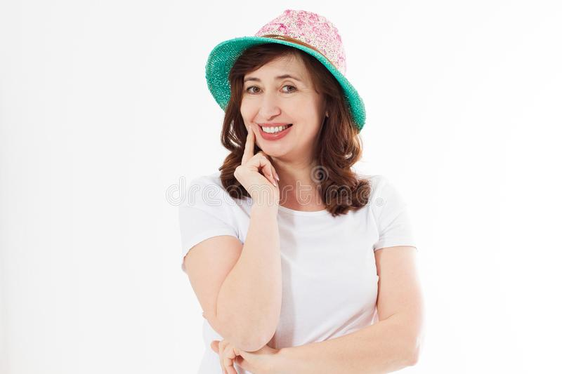 Happy woman in summer hat isolated on white background. Sun protection skin care and vacation holidays concept. Middle age female royalty free stock photography