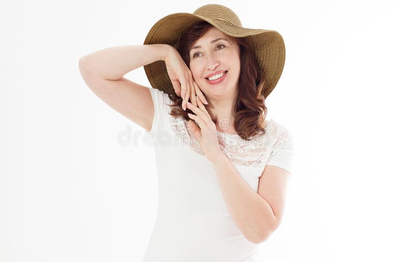 Happy woman in summer hat isolated on white background. Sun protection skin care and vacation holidays concept. Middle age female stock images