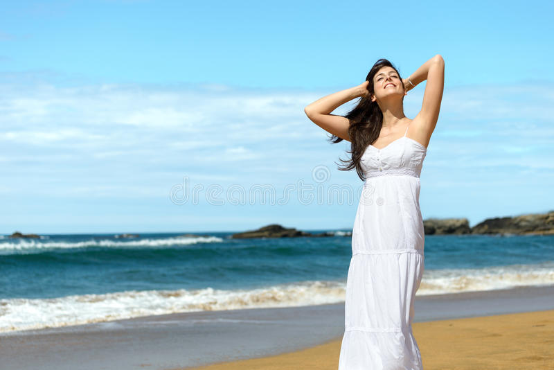 Happy woman on summer vacation royalty free stock photo