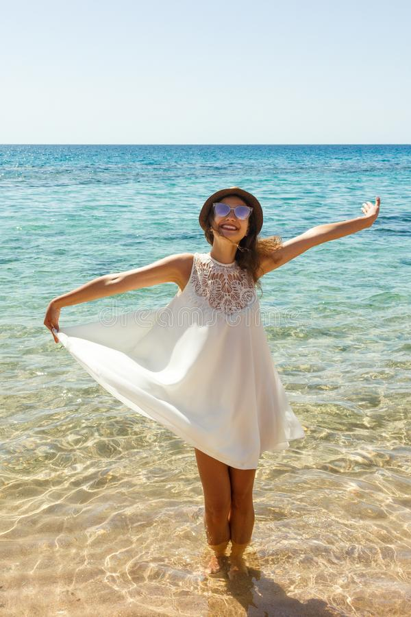 Happy woman in summer white dress on beach. girl relaxing and enjoying peace on vacation stock images