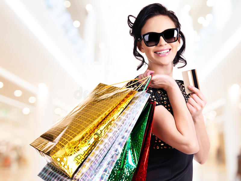Happy woman in sunglasses with purchasing.