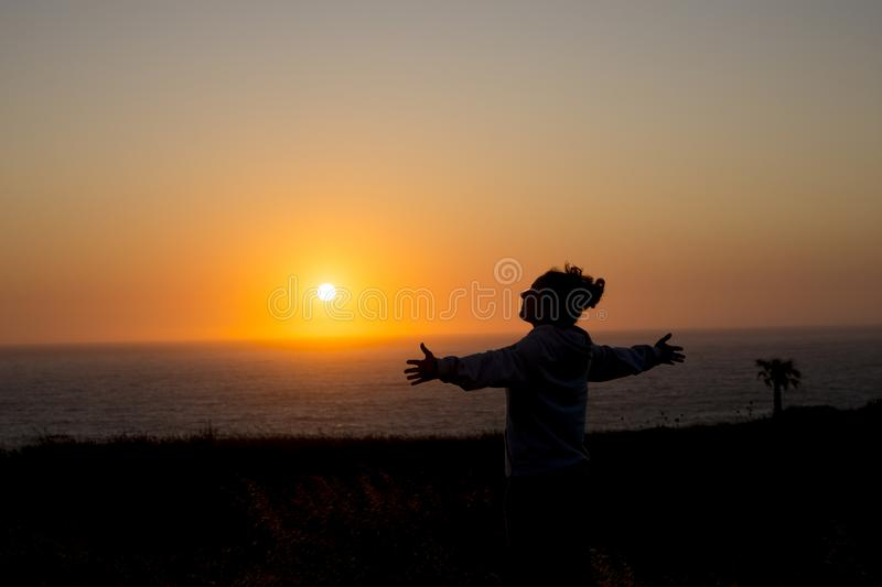 Happy woman at sunset in silhouette royalty free stock photos