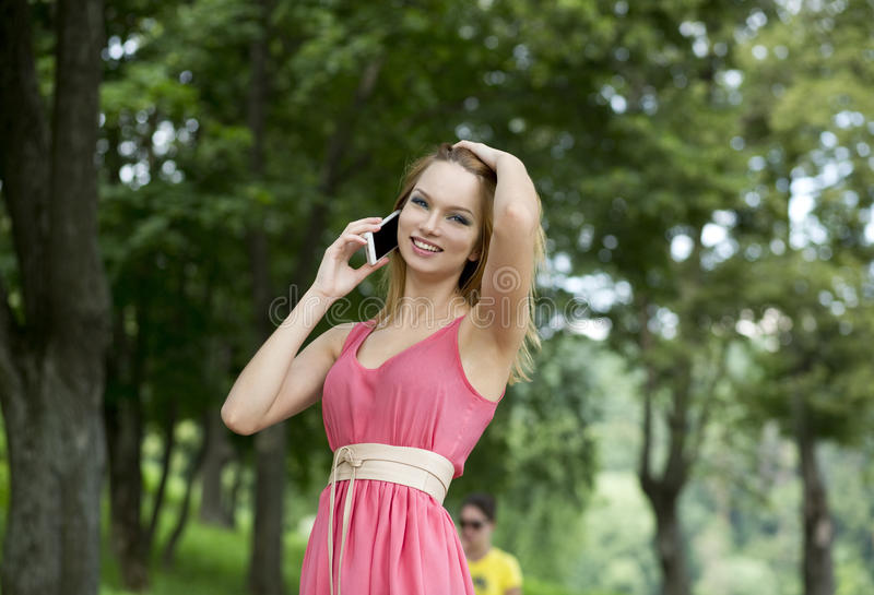 Happy Woman Talking On Cell Phone Stock Photos