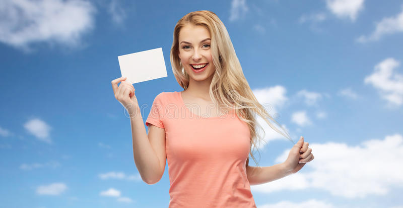 Happy woman or teen girl with blank white paper stock image