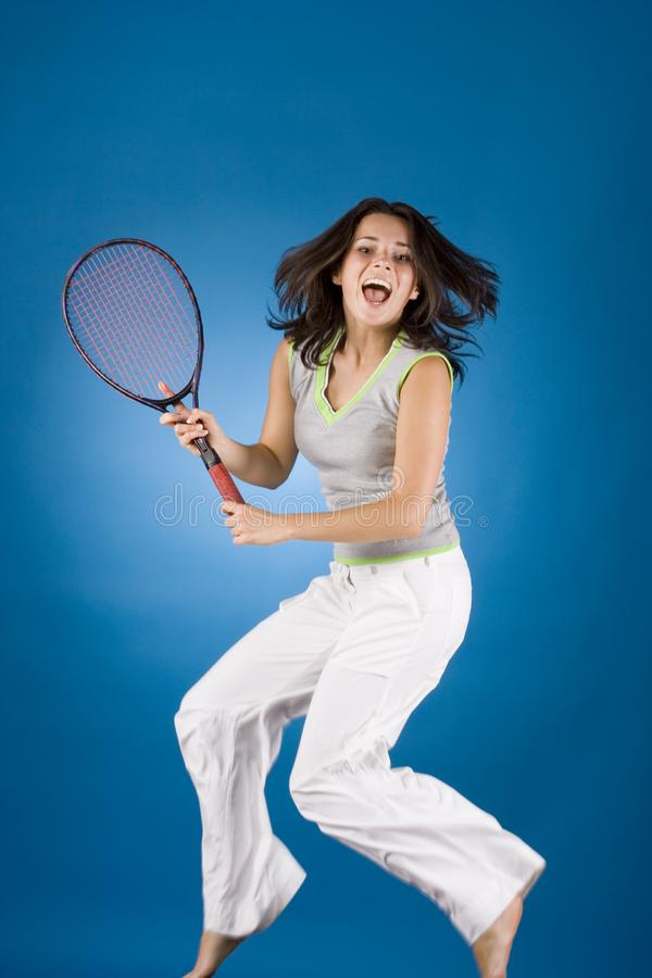 Happy Woman With Tennis Racket Free Stock Photography