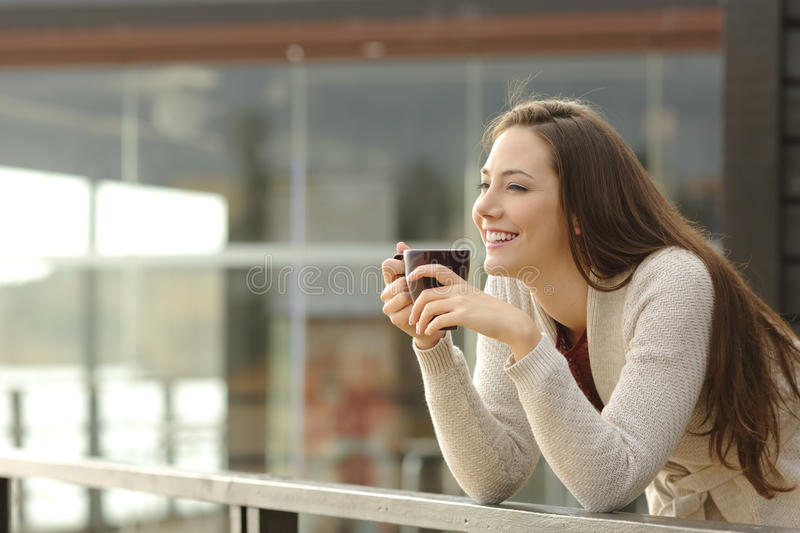 Happy woman thinking at breakfast on vacation royalty free stock images