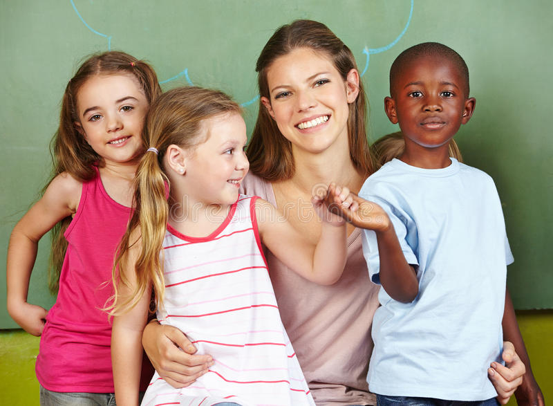 Happy woman with three children stock photos