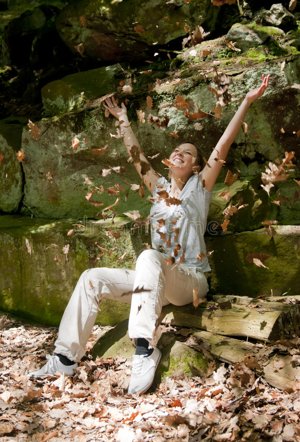 Download Happy Woman Throwing Leaves Stock Image - Image: 17017723