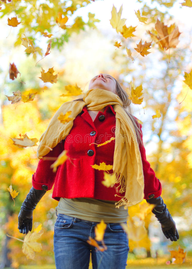 Happy Woman Throwing Leaves Stock Photography